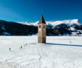A frozen lake & mysterious Curon bell tower.